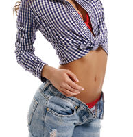 Charming young girl dressed in sexy casual clothes