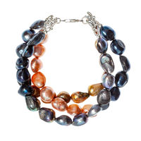 bracelet from stings of river pearls isolated