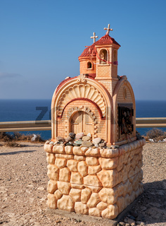 Small roadside chapel (Proskinitari) on the Petra tou Romiou Viewpoint. Limassol. Cyprus