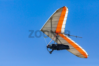 Hang glider flight against the blue sky