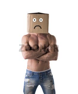 Muscular shirtless bodybuilder with sad