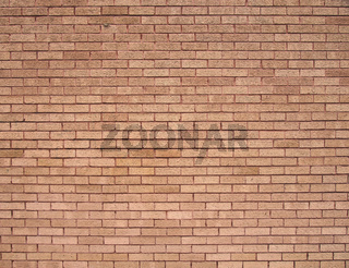 a full frame light brown textured brick wall background