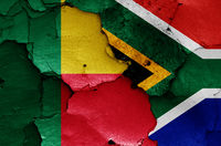 flags of Benin and South Africa painted on cracked wall