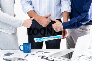 Group of business people showing thumbs up