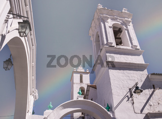 Rainbow at Colonial buildings in Sucre, Bolivia