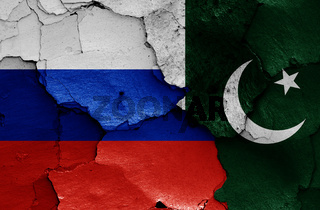 flags of Russia and Pakistan painted on cracked wall