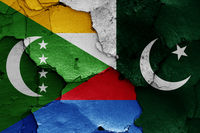 flags of Comoros and Pakistan painted on cracked wall
