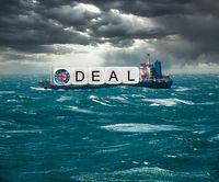 Global trading with container ship carrying Brexit containers as concept for December 2020