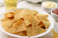 Plate of nacho corn chips and dips
