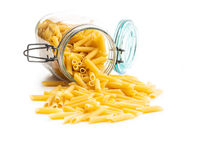 Uncooked penne pasta. Dried italian pasta in jar