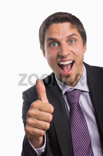 Cheerful businessman gesturing thumbs up
