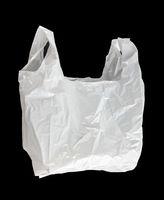 White plastic bag isolated on black background
