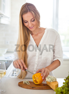 Woman cooking vegetables salad at the  kitchen