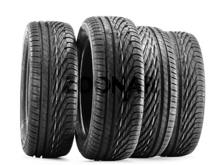 Four new black tires isolated on white background