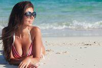 Woman lying on tropical beach