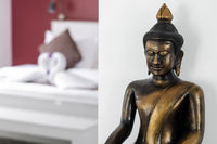 bronze buddha statue interior design detail in modern asian home