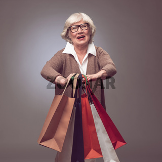 Senior woman with shopping bags