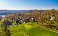 Aerial view of single family homes in a golf community in the fall outside Morgantown in West Virginia