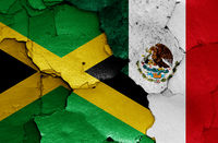 flags of Jamaica and Mexico painted on cracked wall