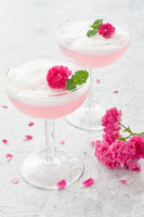 Pink cocktail with rose flowers