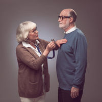 Senior woman checking heart beat