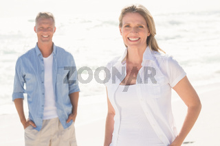 Happy couple smiling at camera