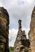 rock climbers on top of a rock pillar in the Elbsandstone mountains in Saxon Switzerland