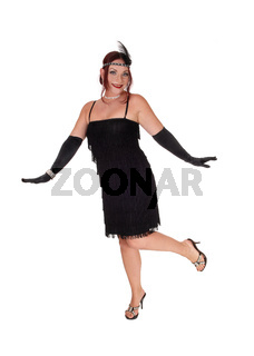 Woman dancing in a black dress and cloves