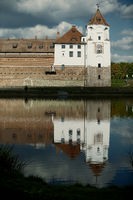 Ancient castle with water reflection under a beautiful sky.
