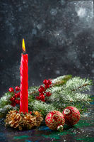 Christmas candle with fir branches.