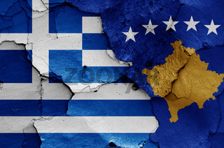 flags of Greece and Kosovo painted on cracked wall
