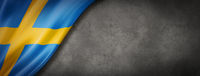 Swedish flag on concrete wall banner