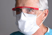 Portrait of a medical professional wearing scruba and Personal Protective Equipment, PPE. Closeup Head only.