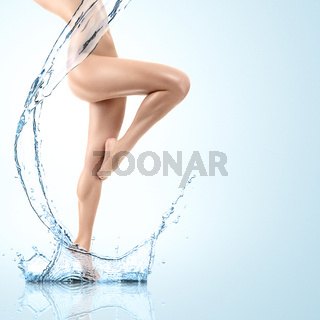 Young woman with water splash