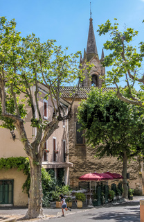 Village square and church of Villars in Provence