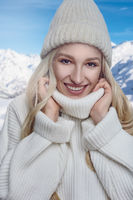 Attractive blond woman in a warm woollen polo neck