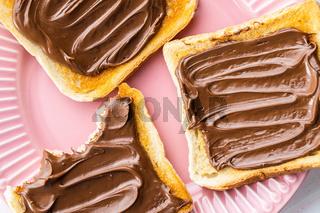 Toast bread with hazelnut spread. Sweet chocolate cream.