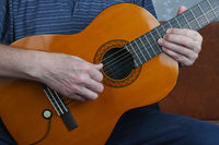 An home  man with nervous hands plays a classic guitar jazz  music