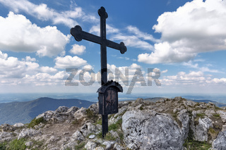 Summit cross on the Fockenstein peak in Bavaria, Germany, in springtime