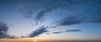 Fluffy clouds in evening sunset sky panoramic view. Climate, environment and weather concept cloudscape background.