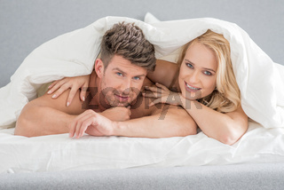 Middle Age Sweet Lovers on White Bed