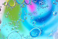 Defocused multicolored abstract background picture made with oil, water and soap with mooving boubbles