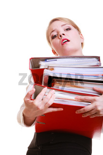 Young overworked business woman holding stack folders documents