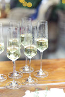 Glasses of sparkling wine on wooden table on Christmas