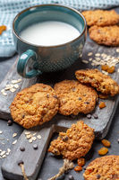 Cookies made from oatmeal, raisins and chocolate.
