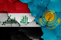 flags of Iraq and Kazakhstan painted on cracked wall