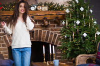 Satisfied woman near Christmas tree