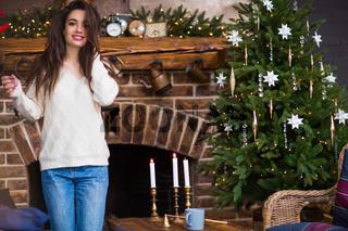 Satisfied woman near Christmas tree