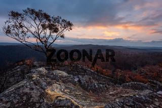 Sunset sky and rain over burnt bushland in Australia