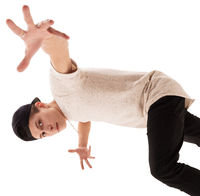 Young handsome rap dancer in baseball cap jumping